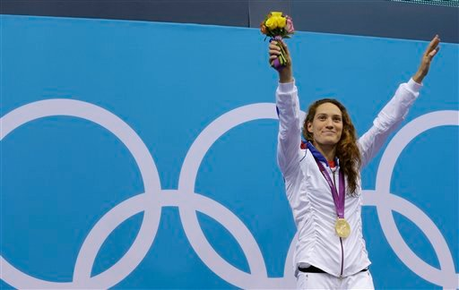 In this Sunday, July 29, 2012 file photo France's Camille Muffat celebrates with her gold medal for the women's 400-meter freestyle swimming final at the Aquatics Centre in the Olympic Park during the 2012 Summer Olympics in London. Two helicopters carryi