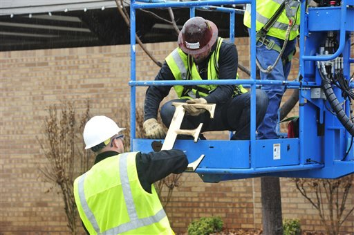 Facility workers removed the letters from the Sigma Alpha Epsilon house at the University of Oklahoma on Monday, March. 9, 2015 in Norman, Okla. University President David Boren severed the school's ties with a national fraternity on Monday and ordered th