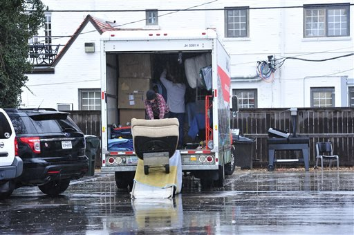Students at the Sigma Alpha Epsilon house load up a moving truck with their belongings at the University of Oklahoma on Monday, March 9, 2015 in Norman, Okla. President David Boren of the University of Oklahoma severed the school's ties with a national fr