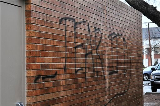 "Graffiti proclaiming ""Tear it down"" is painted on the side of the Sigma Alpha Epsilon house at the University of Oklahoma on Monday, March. 9, 2015 in Norman, Okla. President David Boren of the University of Oklahoma severed the school's ties with a natio"
