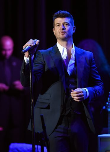 In this Thursday, Feb. 5, 2015 file photo, singer Robin Thicke performs at the 17th Annual GRAMMY Foundation Legacy Concert at the Wilshire Ebell Theatre in Los Angeles.