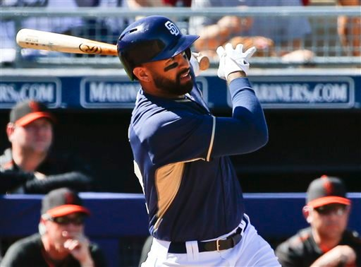 San Diego Padres' Matt Kemp watches his three-run home run in the third inning against the San Francisco Giants in a spring training baseball game Tuesday, March 10, 2015, in Peoria, Ariz.