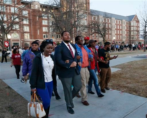 University of Oklahoma students march to the now closed University of Oklahoma's Sigma Alpha Epsilon fraternity house during a rally in Norman, Okla., Tuesday, March 10, 2015. (AP)