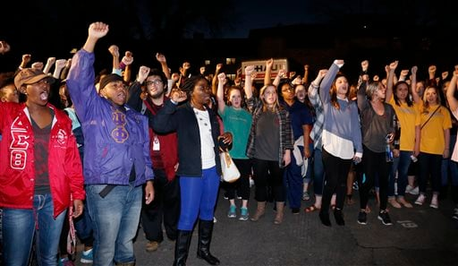 University of Oklahoma students rally outside the now closed University of Oklahoma's Sigma Alpha Epsilon fraternity house during a rally in Norman, Okla. March 10, 2015. (AP Photo/Sue Ogrocki)