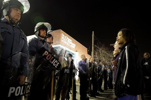 Police and protesters square off outside the Ferguson Police Department, Wednesday, March 11, 2015, in Ferguson, Mo. (AP Photo/Jeff Roberson)