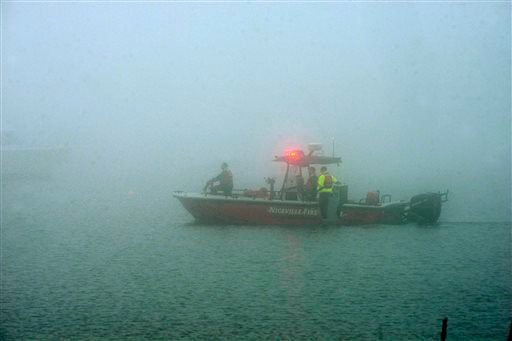 Niceville Fire Dpt search boat is shrouded in fog as rescue workers search the site March 11, 2015 near Navarre Beach, Fla. where an Army Black Hawk helicopter crashed Tuesday evening. (AP Photo/Northwest Florida Daily News, Devon Ravine)
