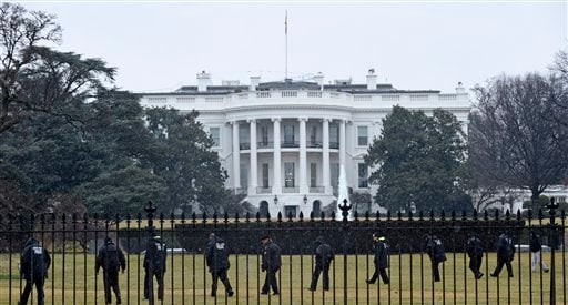 In this Jan. 26, 2015 file photo, Secret Service officers search the south grounds of the White House in Washington after an unmanned aerial drone was found on the White House grounds during the middle of the night.