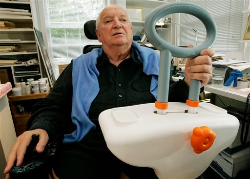 FILE - In this Sept. 11, 2009 file photo, architect and designer Michael Graves sits in his Princeton, N.J. studio holding a bathtub handle he designed to help the handicapped and elderly. (AP)