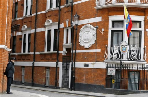 A police officer stands outside of the Ecuadorean embassy in London, Friday, March 13, 2015. Swedish prosecutors on Friday offered to travel to London to question WikiLeaks founder Julian Assange, who has been living at the Ecuadorean embassy in London si