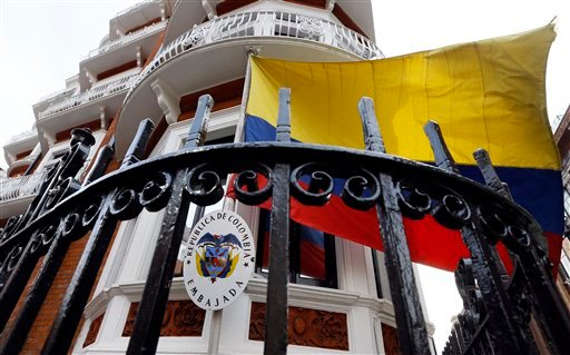 The flag flies outside of the Ecuadorean embassy in London, Friday, March 13, 2015. Swedish prosecutors on Friday offered to travel to London to question WikiLeaks founder Julian Assange, who has been living at the Ecuadorean embassy in London since 2012,