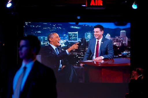 A Secret Service Agent stands by a screen showing a live feed as President Barack Obama talks with Jimmy Kimmel as they are taped on Jimmy Kimmel Live, in Los Angeles on Thursday, March 12, 2015. After the taping the president is expected to attend a DNC