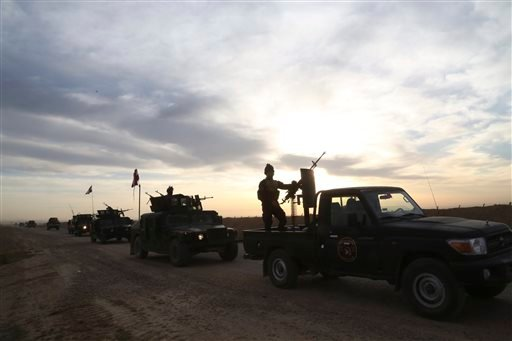 Iraqi security forces patrol in Tikrit, 80 miles (130 kilometers) north of Baghdad, Iraq, Thursday, March 12, 2015. Rockets and mortars echoed across Saddam Hussein's hometown of Tikrit on Thursday as Iraqi security forces clashed with Islamic State milit