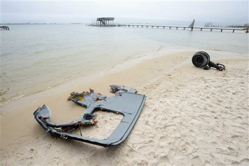 A wheel and pieces of fuselage from an Army Black Hawk helicopter sit along the shoreline of Santa Rosa Sound near Navarre, Fla. on Wednesday, March 11, 2015.