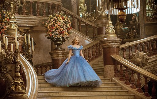 """This image released by Disney shows Lily James as Cinderella in Disney's live-action feature film inspired by the classic fairy tale, """"Cinderella."""" (AP Photo/Disney, Jonathan Olley)"""