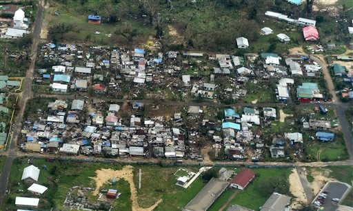 """Damage to houses in Port Vila, Vanuatu is seen from the air in the aftermath of Cyclone Pam Monday, March 16, 2015. Vanuatu's President Baldwin Lonsdale said Monday that the cyclone that hammered the tiny South Pacific archipelago over the weekend was a """""""