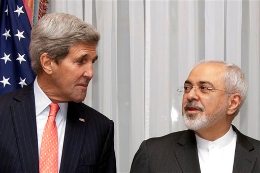 U.S. Secretary of State John Kerry, left, listens to Iran's Foreign Minister Mohammad Javad Zarif, right, before resuming talks over Iran's nuclear program in Lausanne, Switzerland, Monday, March 16, 2015. The United States and Iran are plunging back into