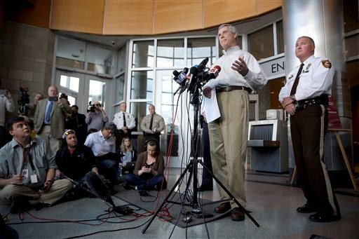 St. Louis County Prosecutor Robert McCulloch, left, speaks during a news conference as St. Louis County Police Chief Jon Belmar listens Sunday, March 15, 2015, in Clayton, Mo. McCulloch said 20-year-old Jeffrey Williams has been charged with two counts of