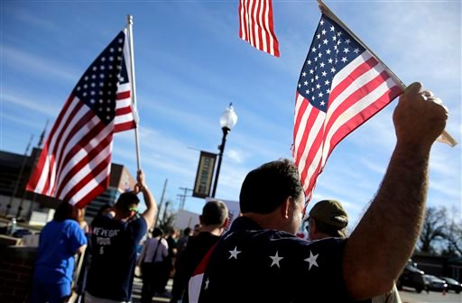 Pro-police demonstrators stand outside the Ferguson Police Department Sunday, March 15, 2015, in Ferguson, Mo. (AP Photo/Jeff Roberson)
