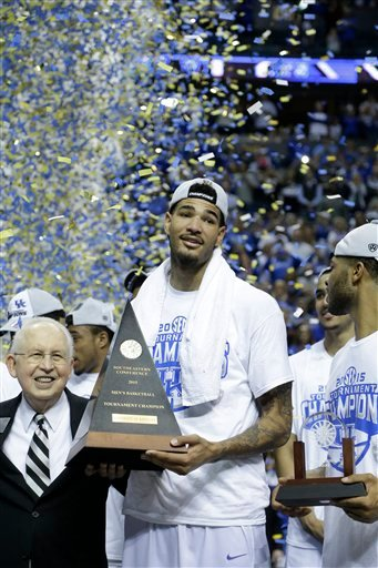 Kentucky forward Willie Cauley-Stein holds the trophy after the NCAA college basketball Southeastern Conference tournament championship game against Arkansas, Sunday, March 15, 2015, in Nashville, Tenn. Kentucky won 78-63. (AP Photo/Mark Humphrey)
