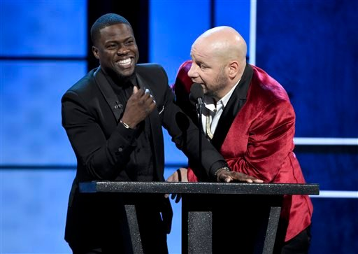Host Kevin Hart, left, and Jeffrey Ross appear on stage at the Comedy Central Roast of Justin Bieber at Sony Pictures Studios on Saturday, March 14, 2015, in Culver City, Calif.