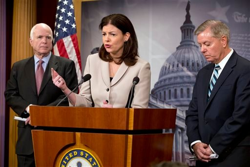 In this Jan. 13, 2015, file photo, Sen. Kelly Ayotte, R-N.H., center, flanked by Senate Armed Services Committee Chairman Sen. John McCain, R-Ariz., left, and and Sen. Lindsey Graham, R-S.C., speaks during a news conference on Capitol Hill in Washington,