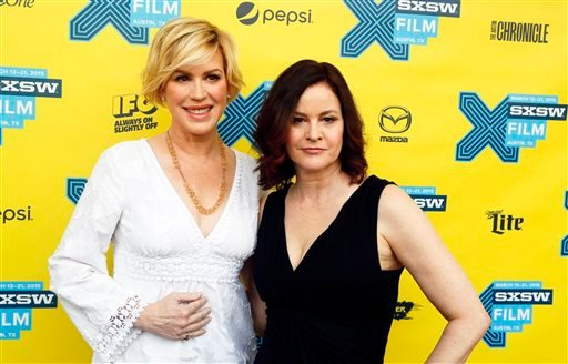"Molly Ringwald, left, and Ally Sheedy walk the red carpet for ""The Breakfast Club"" 30th Anniversary Restoration World Premiere during the South by Southwest Film Festival on Monday, March 16, 2015 in Austin, Texas. (Photo by Jack Plunkett/Invision/AP)"