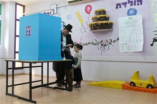 An ultra-Orthodox Jew prepares to vote in Bnei Brak, Israel, Tuesday, March 17, 2015. Israelis are voting in early parliament elections following a campaign focused on economic issues such as the high cost of living, rather than fears of a nuclear Iran or
