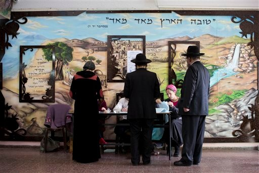Ultra-Orthodox Jews line up to vote in Bnei Brak, Israel, Tuesday, March 17, 2015. Israelis are voting in early parliament elections following a campaign focused on economic issues such as the high cost of living, rather than fears of a nuclear Iran or th