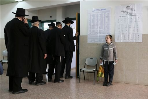 Ultra orthodox Jewish rabbi Gershon Edelstein prepares to vote in Bnei Brak, Israel, Tuesday, March 17, 2015. Israelis are voting in early parliament elections following a campaign focused on economic issues such as the high cost of living, rather than fe