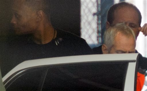 Robert Durst is escorted from Orleans Parish Criminal District Court, Monday, March 16, 2015, in New Orleans. Durst, a millionaire from one of America's wealthiest families, agreed Monday to return to Los Angeles to face a 15-year-old murder charge after