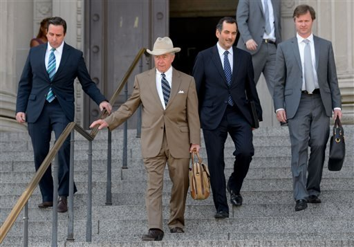 Robert A. Durst's attorneys including Dick DeGuerin, second left, and William P. Gibbens, far right, leave Orleans Parish Criminal District Court in New Orleans, La. Monday, March 16, 2015, after a hearing for Durst's extradition to Los Angeles to face a