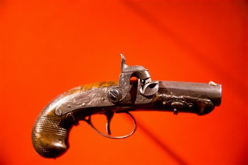 "John Wilkes Booth's derringer pistol used to kill President Abraham Lincoln is displayed at a new exhibit entitled ""Silent Witnesses: Artifacts of the Lincoln Assassination."" (AP)"