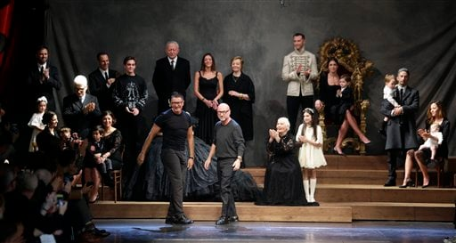 In this Jan. 17, 2015 file photo, fashion designers Domenico Dolce, right, and Stefano Gabbana acknowledge the applause of the audience after presenting their Dolce & Gabbana men's Fall-Winter 2015-2016 collection, part of the Milan Fashion Week. (AP)