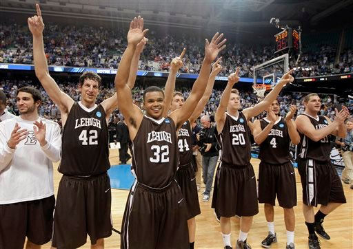 In this Friday, March 16, 2012 file photo, Lehigh's Gabe Knutson (42), B.J. Bailey (32), Jordan Hamilton (44), Holden Greiner (20), John Adams (4) and Justin Maneri (31) celebrate after winning an NCAA tournament second-round college basketball game.