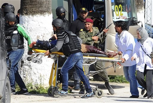 A victim is being evacuated by rescue workers outside the Bardo museum in Tunis, Wednesday, March 18, 2015 in Tunis, Tunisia. (AP Photo/Hassene Dridi)
