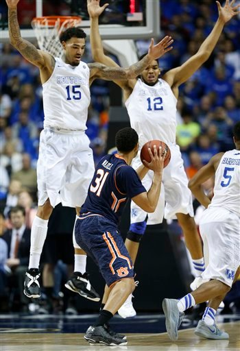 Auburn guard Devin Waddell (31) looks to shoot against Kentucky forward Willie Cauley-Stein (15) and Kentucky forward Karl-Anthony Towns (12) during the second half of an NCAA college basketball game.