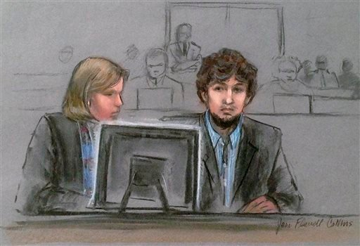 In this courtroom sketch, Dzhokhar Tsarnaev, right, and defense attorney Judy Clarke are depicted watching evidence displayed on a monitor during his federal death penalty trial Monday, March 9, 2015, in Boston. (AP)