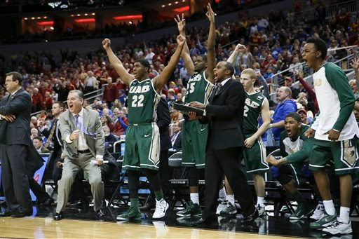 The UAB bench cheers after guard Robert Brown hit a 3-point basket in the closing seconds of the second half against Iowa State in the second round of the NCAA college basketball tournament in Louisville, Ky., Thursday, March 19, 2015. UAB won the game 60