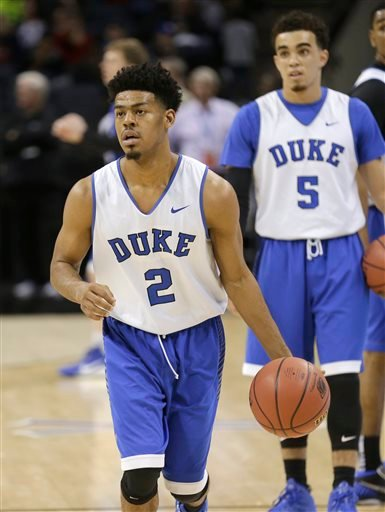 Duke's Quinn Cook (2) runs a drill during practice at the NCAA college basketball tournament in Charlotte, N.C., Thursday, March 19, 2015. Duke plays Robert Morris in the second round on Friday. (AP Photo/Gerald Herbert)
