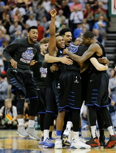 Georgia State players celebrate as they surround R.J. Hunter (22 after he made the game-winning shot against Baylor late in the second half in the second round of the NCAA college basketball tournament, Thursday, March 19, 2015, in Jacksonville, Fla. Geor