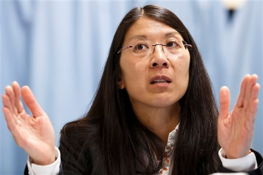 In this Tuesday, Feb. 18, 2014 file photo, Joanne Liu, International President of Medecins sans Frontieres (Doctors without Borders) speaks about the humanitarian situation in Central African Republic, during a news conference in Geneva, Switzerland. In a