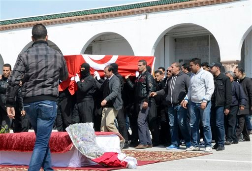 Tunisian police officers carry the coffin of elite security member Aymen Morjen, Thursday March 19, 2015 in Tunis. Morjen was killed in the Wednesday attack at the Bardo National museum. The Islamic State group issued a statement Thursday claiming respons