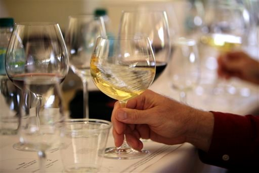 File - In this May 20, 2009 file photo a glass of white wine is swirled during a tasting in Oakville, Calif. (AP)