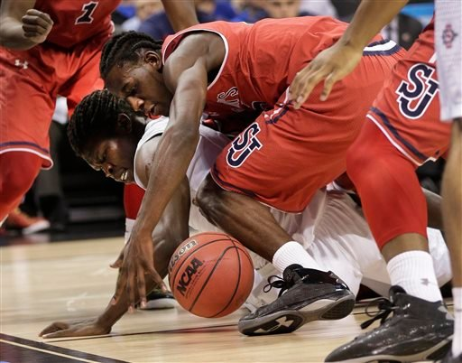 San Diego State's Angelo Chol, left, and St. John's Sir'Dominic Pointer, right, battle for the ball during the first half of an NCAA tournament college basketball game in the Round of 64 in Charlotte, N.C., Friday, March 20, 2015. (AP Photo/Nell Redmond)