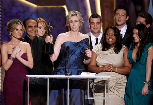 "In this Jan. 23, 2010 file photo, Jane Lynch, center, and the cast of ""Glee"" accept the award for best ensemble in a comedy series at the 16th Annual Screen Actors Guild Awards in Los Angeles. ""Glee"" will conclude its six-season run with a two-hour final"