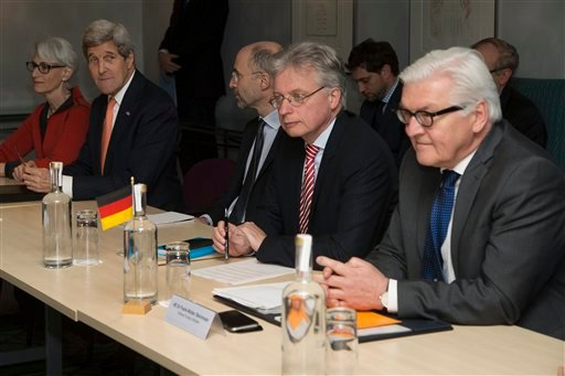 U.S. Secretary of State John Kerry (2nd left) and German Foreign Minister Frank Walter Steinmeier (Right) attend a meeting about the recently concluded round of negotiations with Iran over Iran's nuclear program, in London, England, Saturday, March 21, 20