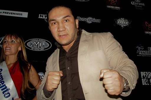 In this May 27, 2010 photo, Mexican wrestler Pedro Aguayo Ramirez, known as Hijo del Perro Aguayo, poses for photographers at the start of a news conference in Mexico City. Ramirez, the son of a wrestling legend in the country, died early Saturday March 2