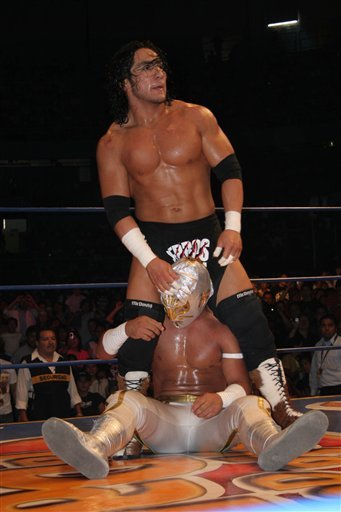 In this April 13, 2007 photo, Mexican wrestler Pedro Aguayo Ramirez, known as Hijo del Perro Aguayo, top, tries to remove the mask of Mistico during a wrestling match in Mexico City. Ramirez, the son of a wrestling legend in the country, died early Saturd