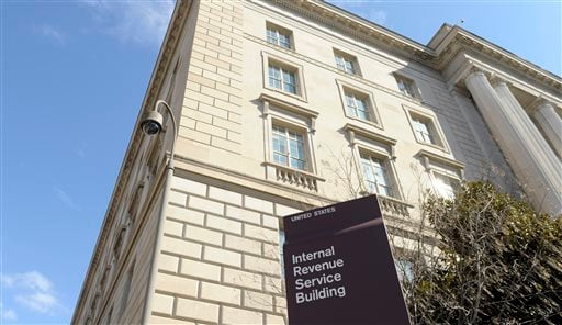 This March 22, 2013, file photo, shows exterior of the Internal Revenue Service building in Washington. New data show that cash-strapped Americans anxious for tax refunds are increasingly turning to payment advances and prepaid cards when getting tax prep