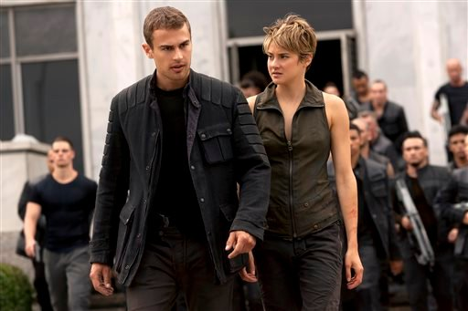 "In this image released by Lionsgate, Theo James, left, and Shailene Woodley appear in a scene from the film, ""The Divergent Series: Insurgent."" (AP Photo/Lionsgate, Andrew Cooper)"